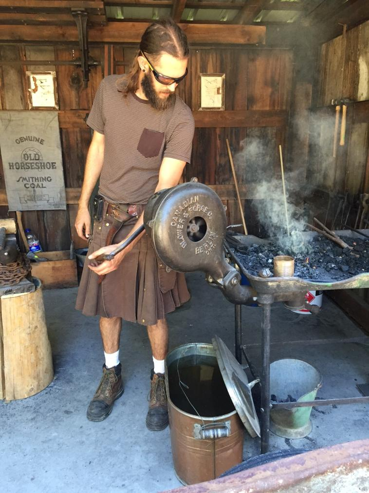 Caldwell Heritage Farm | Blacksmith hard at work