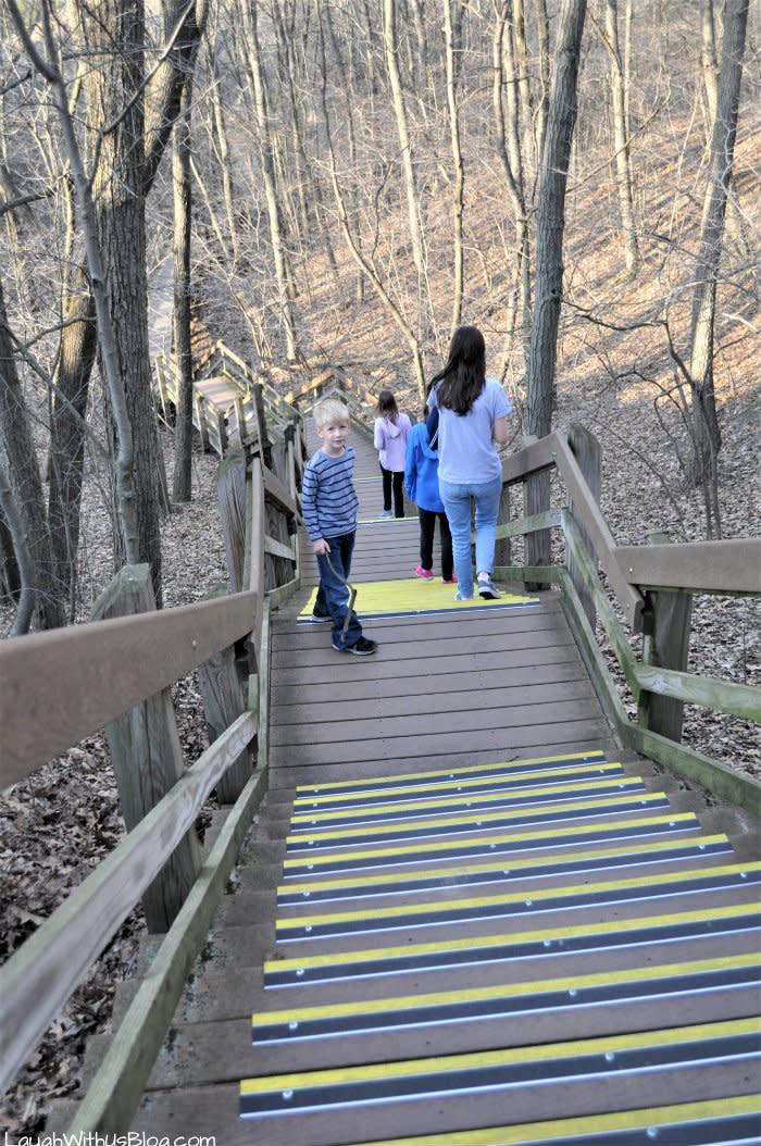 Children walking down the West Beach trail's wooden stairs