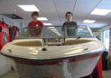 Jacob (left) and Adam Cooper, seen here at Cooper's Marina in Baldwinsville, earned their Young Boater Safety Certificates at the 2010 Central New York Boat Show. Photo: Cooper's Marina