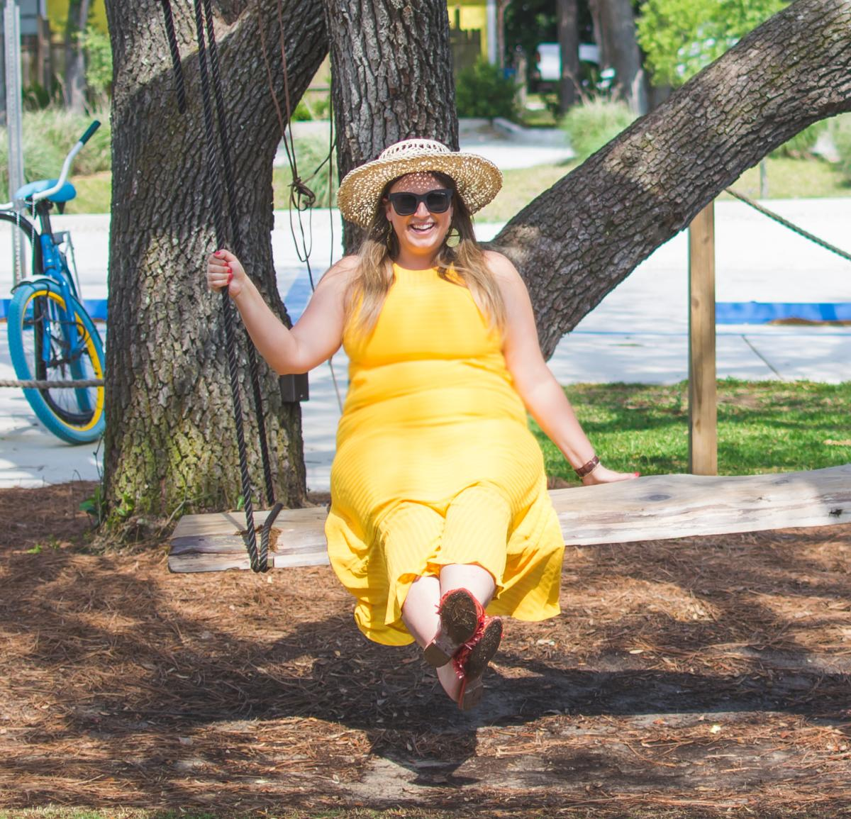 Woman of Lace and Grace sitting on a Tree Swing