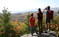A family enjoys the view from atop Coon Mountain in Westport on Lake Champlain.
