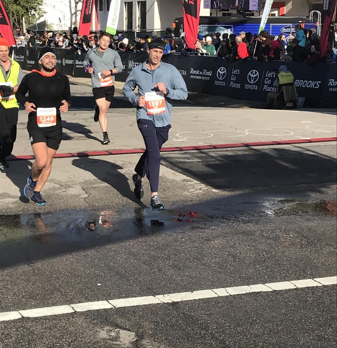 Neil Amato finishing the 2018 Rock 'n' Roll Raleigh Half-Marathon