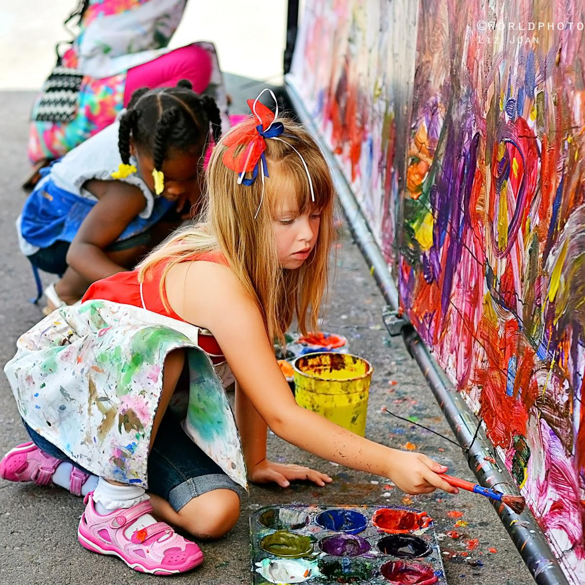 Little girls painting at the Cherry Creek Arts Festival