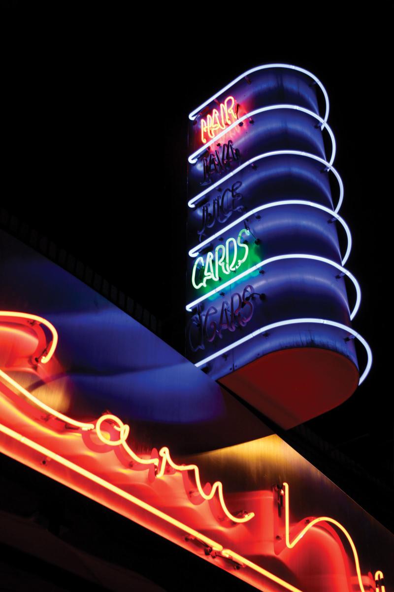 Neon signs on 66 include Laru Ni Hati Salon and Wine Bar