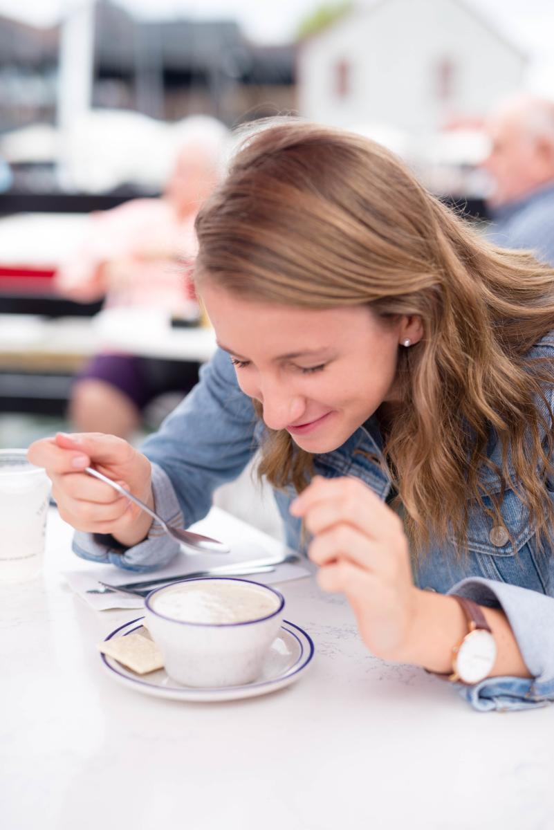 Woman Eating Chowder