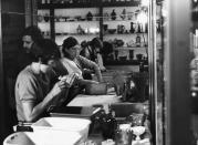 Volunteers wash glass objects at the Corning Museum of Glass after 1972 flood.