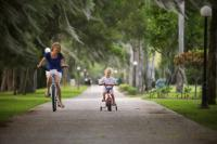 A mother and daughter enjoy biking in the Golden Isles of Georgia, a favorite free family-friendly activity