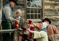 Villagers gather at the Genesee Country Village brewery to fill their containers, as the historic village is busy Preparing for the Holidays—the 19th-Century Way on Nov. 24.