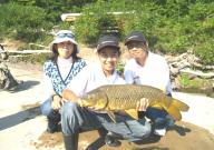 13-year-old Lintaro Kajiwara holds a hefty Oswego River carp as his parents Shiho (left) and Munenori Kajiwara look on. All of the fish caught during that session were released back into the river. Lintaro was fishing with Mike McGrath and Associates in Minetto.