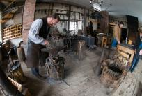 Blacksmith Steve Kellogg demonstrates age-old techniques to visitors during last year's Sugaring Off Sundays event at The Farmers' Museum.  (Photo by Zach Winnie)