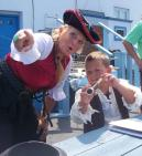 Captain Jonel shows crew memeber Anthony Harter of Oswego where to look for bounty to plunder during a 2012 Kids' Pirate Day at the H. Lee White Museum and Maritime Center.