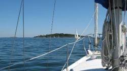 View from sailboat on the water off the coast of Maine