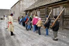 Children learn and practice 18th century military life at Winter Camp for Kids at Old Fort Niagara, located at the junction of the Niagara River and Lake Ontario. The Fort is reached by traveling the Great Lakes Seaway Trail, an America's Byway. Photo: courtesy of Wayne Peters