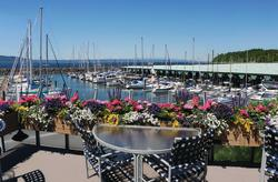 Anthony's HomePort patio and flowers looking out over marina