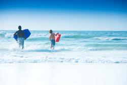 Fun with boogie boards at Wrightsville Beach