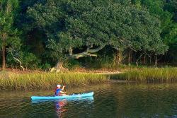 Solo kayaker in river