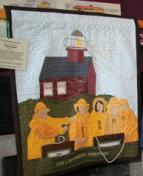"""This storytelling quilt by Nancy Smith of Syracuse, NY, tells of her """"Great Lakes Seaway Trail Lighthouse Adventure."""" Nancy won an overnight stay at Selkirk Lighthouse with her family by entering a past Great Lakes Seaway Trail quilt challenge competition. Beauty of the Byways is the 2013 challenge theme for quilters across the U.S. and Canada."""