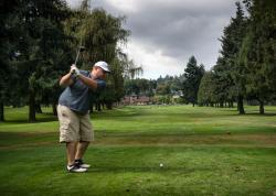 Man Teeing off at Fosters Golf Links in Tukwila