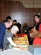 """Participants during a previous """"Material Matters"""" program examine original examples of 18th-century clothing. Fort Ticonderoga hosts the Third Annual """"Material Matters: It's in the Details"""" Seminar on January 26 & 27, 2013. Registration is now open for this weekend seminar."""