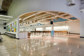 Interior photo of Cruise Terminal 19 check-in counter area