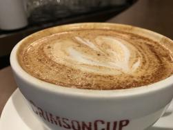 Close-up of a frothy, foamy cup of coffee from Crimson Cup