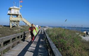 A surfer heads out to Ponce Inlet