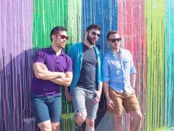 Men posing at the Biscuit Paint Wall in Houston