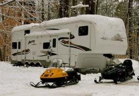 Travel trailer and snowmobiles