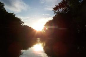 Sun reflecting on the Iroquois River in Northwest Indiana