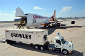 Image of a Crowley ocean container and a 747 cargo plane on the runway.