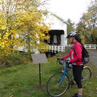 Cottage Grove Covered Bridge & Cyclist