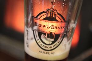 brew-n-brats-naples-beer-glass-by-fire