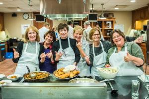 Celebrating a well cooked meal in the hands-on kitchen at the New York Wine & Culinary Center