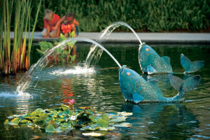 Koi-shaped fountains in a pond at Fashion Island