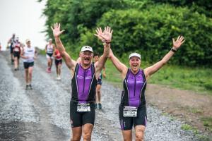 mussle-man-geneva-runners-finish-line