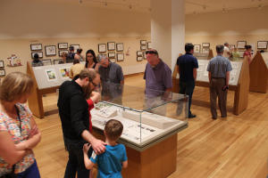 People at an exhibition at the Billy Ireland Cartoon Museum