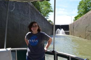 Girl stands on Sam Patch Tour Boat in a lock on the Erie Canal