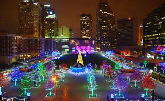 Bird's-eye view of the Columbus Commons illuminate for the holidays with a rainbow array of colorful lights in trees