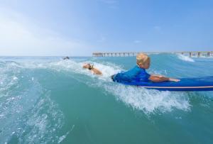 WB Surfing Kid