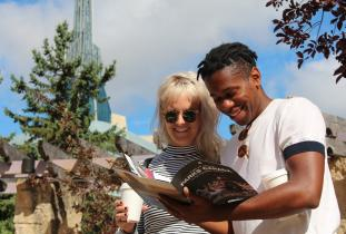 Visitors read a Parks Canada brochure at The Forks National Historic Site.