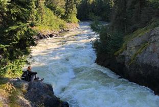 Watching the rushing river at Wekusko Falls