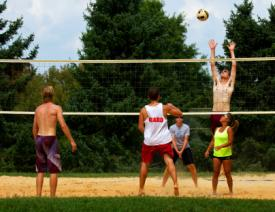 A group playing sand volleyball in Howard County, MD