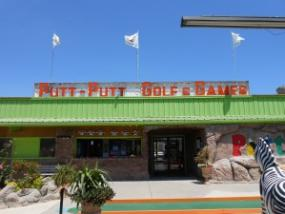 Main entrance to the Putt-Putt greens - see the caddy shack window beside the doors? That's where you find the golf clubs, score cards, pencils and balls.