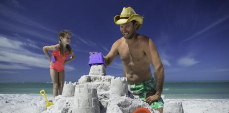 Dad taking over sandcastle construction