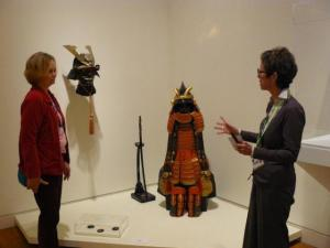 Carol learns about an exhibit from the docent at the Crocker Art Museum.
