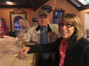 A couple enjoy wine at the bar at Water Side Wine Bar in Phelps