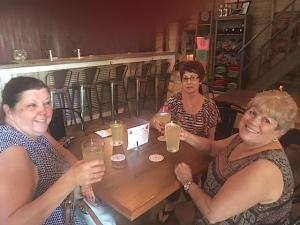 In front, from left, Cheryl Eggelston and Peggy Howey, both of Fort Wayne, propose a birthday toast to Marcia Hoffman, in back, at the Kekionga Cider Company on Maysville Road.
