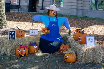 "This scarecrow created by Sonshine School features a teacher and pumpkin ""students."""