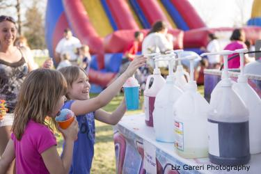 Children make snow cones at Rochester Lilac Festival