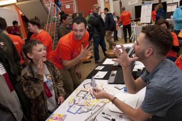 boy learns how to communicate with ASL at Imagine RIT in Rochester, NY